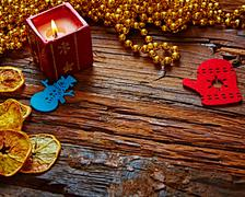 Seasonal rustic Christmas border composed of ornaments over a wooden background Stock Photos