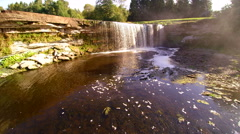 The small river where in the water falls from Jagala Stock Footage