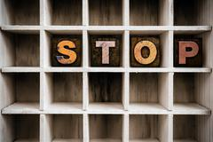 Stop Concept Wooden Letterpress Type in Drawer Stock Photos