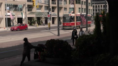 Streetcar in Downtown Toronto on Queens Quay. Stock Footage