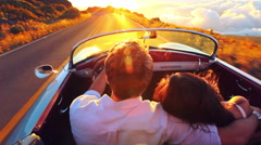 Happy Couple Driving on Country Road into the Sunset in Classic Vintage Sport Stock Footage