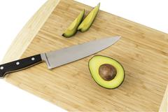 Avacados With Knife - stock photo