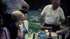 1965: Booze filled picnic table adults enjoying hard liquor and beers. TAMPA, - stock footage