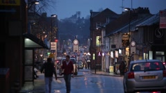 Typical English town centre at night in the rain, Aldershot, England, Europe Stock Footage