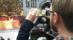 Hipster Tourist Taking Photos at Rockefeller Christmas Tree NYC Stock Footage