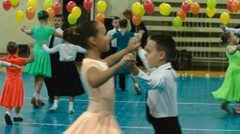 children dancing at a concert in the school hall - stock footage