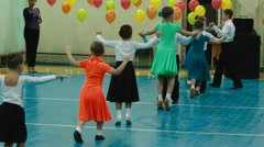 Children dancing at a concert in the school hall Stock Footage