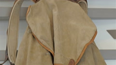 A brown bag hanging on the wall Stock Footage