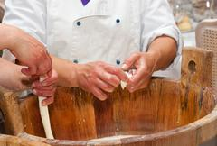 Production handmade craftsmanship of mozzarella - stock photo
