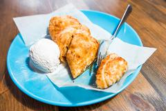 Strudel dessert with ice cream on azure plate Stock Photos