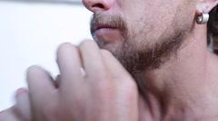 Man tugging his beard Stock Footage