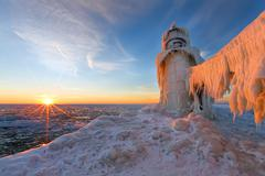 Sunset on a frozen St. Joseph Michigan pier - Michigan Stock Photos
