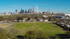 Dallas Skyline & Margaret Hunt Hill Bridge aerial from W Dallas Neighborhood Stock Footage
