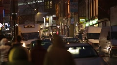 Traffic and crowd in the rain in England, Europe Stock Footage