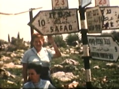 Stock Video Footage of Tourists posing in front of Directional post (Vintage 1950's)