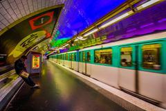 Train moving in parisian subway Metro station, France Kuvituskuvat