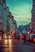 Picturesque parisian city street scene with Eiffel Tower in the background Stock Photos