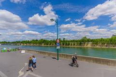 Tourists admiring the beautiful Seine river in Paris, France Stock Photos