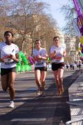 Stock Photo of LONDON - APRIL 13: Unidentified girls run the London marathon on April 13th,