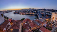 Panorama old city Porto at river Duoro,with Port transporting boats after sunset Stock Footage