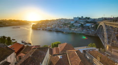 Panorama old city Porto at river Duoro,with Port transporting boats at sunset Stock Footage