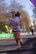 LONDON - APRIL 13: Unidentified girls run the London marathon on April 13th,  Stock Photos