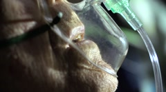 Breathing mask  on senior patient's face Stock Footage