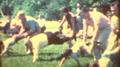 Wheelbarrow race, big company picnic Stock Footage