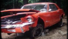 2965 - car wreckage of classic 1965 Ford Mustang - vintage film home movie Stock Footage