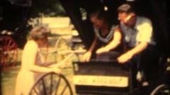 1955   ,couple sitting in buckboard Stock Footage