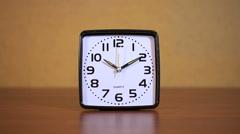 Black square clock alarm Stock Footage