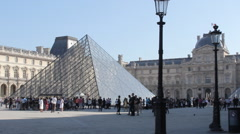 Crowd of People at the Glass Louvre Pyramid in Paris - Handheld Stock Video Stock Footage