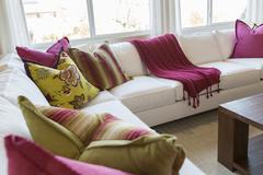 Beautiful Abstract of Inviting Colorful Couch Sitting Area and Table. Stock Photos