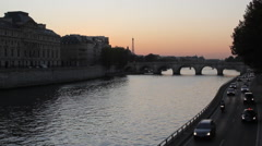 The Seine River with Traffic at Sunset in Paris France Stock Footage