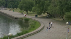 Ungraded: People Walk Along Embankment of River Svisloch Near Trinity Stock Footage