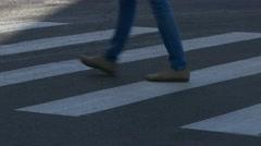 Ungraded: People Walk on Pedestrian Crossing on Deserted Street on Hot - stock footage