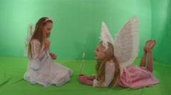 Two beautiful girls dressed as an angel, fun talk. - stock footage
