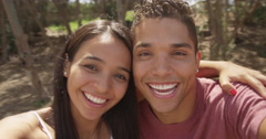 Cute Mexican couple taking selfie while spinning Stock Footage