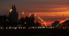 Light trail from intensive traffic on susnet, busy city Stock Footage