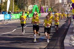 LONDON - APRIL 13: Unidentified girls run the London marathon on April 13th,  - stock photo