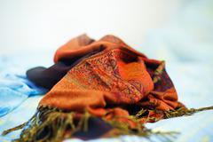 Oriental ornamental crumpled blanket on light blue background Stock Photos