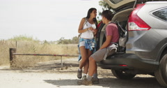 Cute Mexican couple taking break from hiking - stock footage