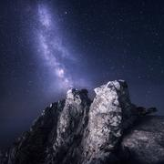 Milky Way. Beautiful night landscape with rocks and starry sky Kuvituskuvat