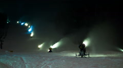 Lots of the snow cannons working at night on a ski slope. Timelapse Stock Footage