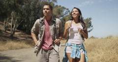 Mexican couple walking on trail Stock Footage