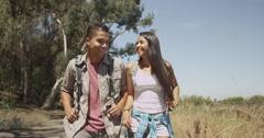 Hispanic couple walking on trail - stock footage