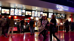 People line up for buying foods at cinema - stock footage