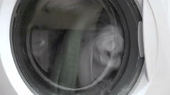 Washing machine washes laundry and stops spinning Stock Footage