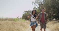 Attractive Mexican couple walking on trail - stock footage