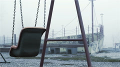 Empty swing in the fog autumn environment Stock Footage